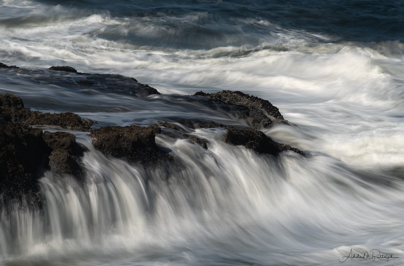 Water cascading off rocks at Cape Perpetua, Oregon. © Adele M. Buttolph, © Adele Buttolph