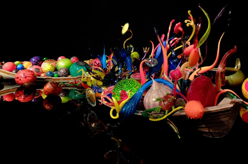 Two boats hold colorful nautical-themes glass objects at Chihuly Garden and Glass, Seattle, Washington.