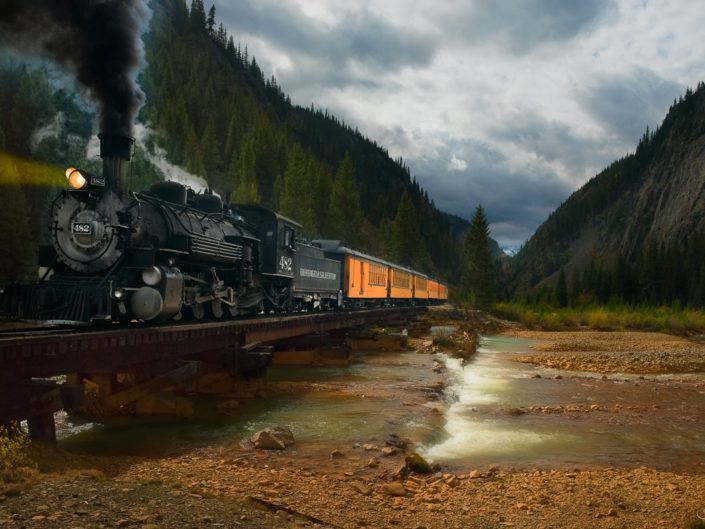 Vintage locomotive number 482 of the Durango & Silverton Railroad crossing the Animas River near Silverton, Colorado