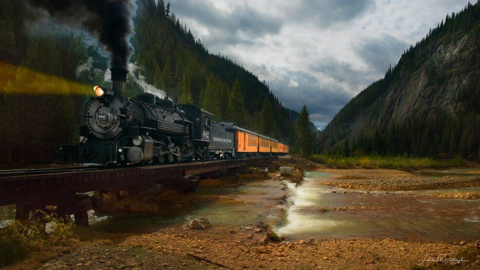 Vintage locomotive number 482 of the Durango & Silverton Railroad crossing the Animas River near Silverton, Colorado