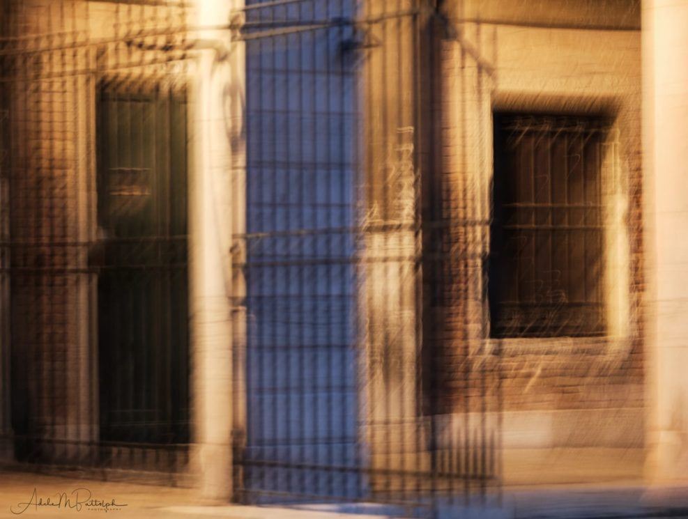 Impressionistic image of a window, door, and gate photographed from a vaporetto in Venice, Italy