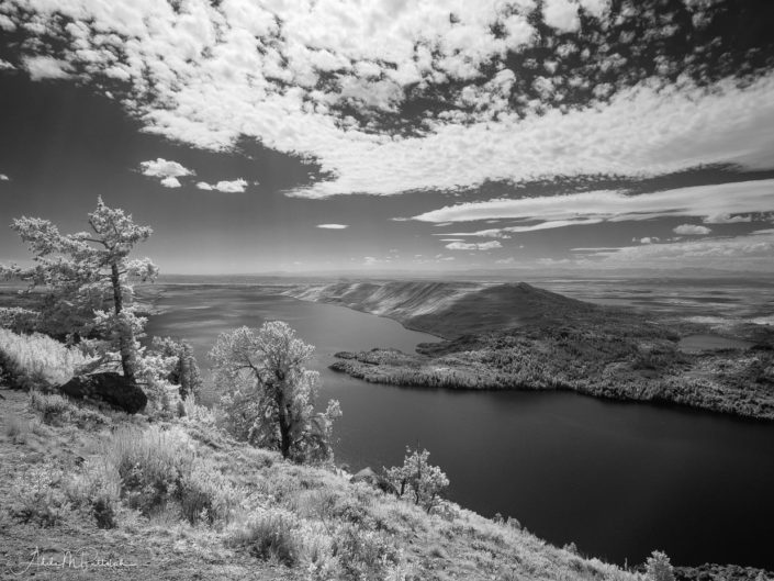 An infrared photograph of Fremon Lake shot from an overlook above the lake.