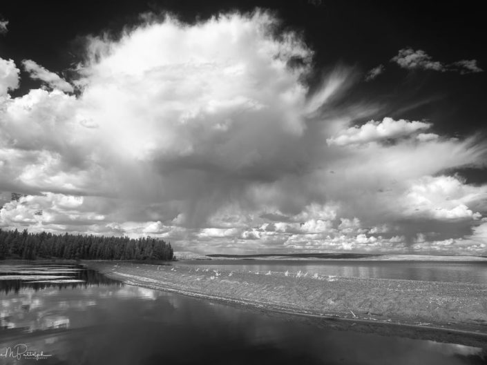 Black and white infrared image of Yellowstone Lake with dramatic clouds.